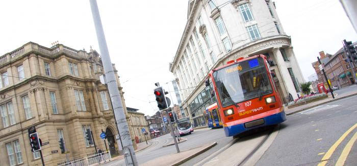 Sheffield Supertram travelling down a city street