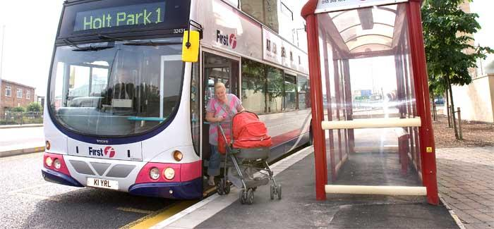 Woman exiting bus with buggy