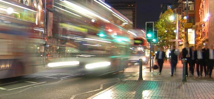Blurred buses on a street at night