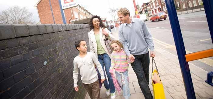 Family walking from station to bus stop