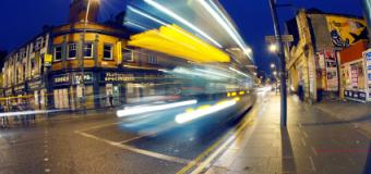 Blurred bus at night