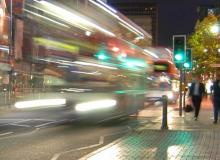 Buses on a city street at night