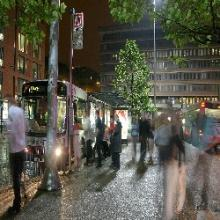 Passengers waiting for an evening bus in Manchester
