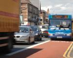 Bus in bus lane passing a traffic jam