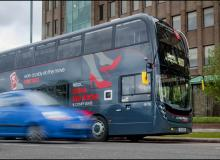 Bus going past cars