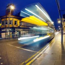 Blurred bus on nighttime street