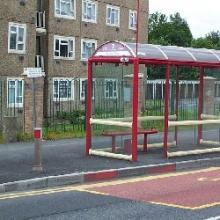Bus stop outside high rise