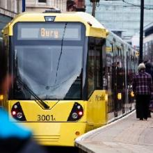 Yellow Metrolink and passengers