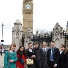 Young people outside Parliament at guide launch